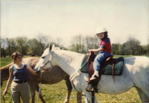 It all started with a pony ride. Kelsey riding